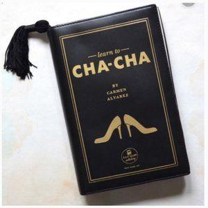 kate spade learn to cha cha book leather clutch